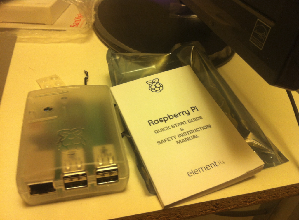 Honestly, I love to carry with me the raw Raspberry Pi 2 motherboard (in a cartoon box) and to connect it as is, but you can use a plastic box. It is also very useful to hang to walls, furniture, or the car.