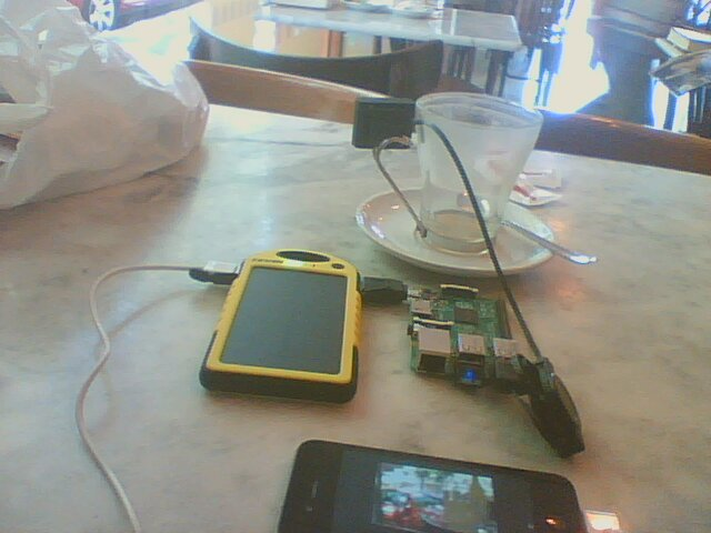 Mounting a USB mini webcam in a glass, while at a bar. The battery is charging the iPhone and powering the Prototype C
